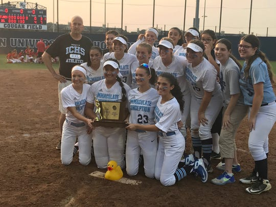 Immaculate Conception coaches and players (and Modi the Duck) enjoy their seventh straight Non-Public B title.