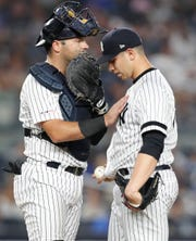 New York Yankees catcher Austin Romine, left, meets with starting pitcher Luis Cessa during the seventh inning of a baseball game against the Boston Red Sox, Sunday, June 2, 2019, in New York. (AP Photo/Kathy Willens)