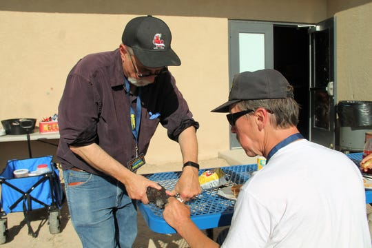 Michael Shinabery of the New Mexico  Museum of Space History shows off a meteorite at the Great Southwest Star Party June 2.