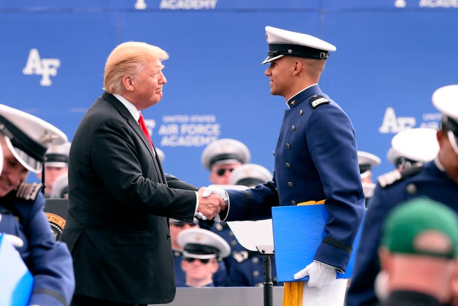 Donald J. Trump, President of the United States congratulates cadets during the U.S. Air Force Academy graduation at Falcon Stadium in Colorado Springs, Colorado, May 30. Nine-hundred-eighty-nine cadets graduated to become the newest 2nd lieutenants in the Air Force.
