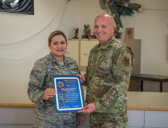 Staff Sgt. Ashley Hussain, 54th Operations Support Squadron Aircrew Flight Equipment main shop noncommissioned officer in charge, receives the Chief's Choice Award from Chief Master Sgt. Vincent Miller, 54th Fighter Group command chief, May 22, 2019, on Holloman Air Force Base, N.M. Holloman's Chiefs Group has a monthly recognition program titled Chief's Choice Award. Every month, a chief has the honor of choosing a deserving Airman for an outstanding act or for continuous outstanding performance.