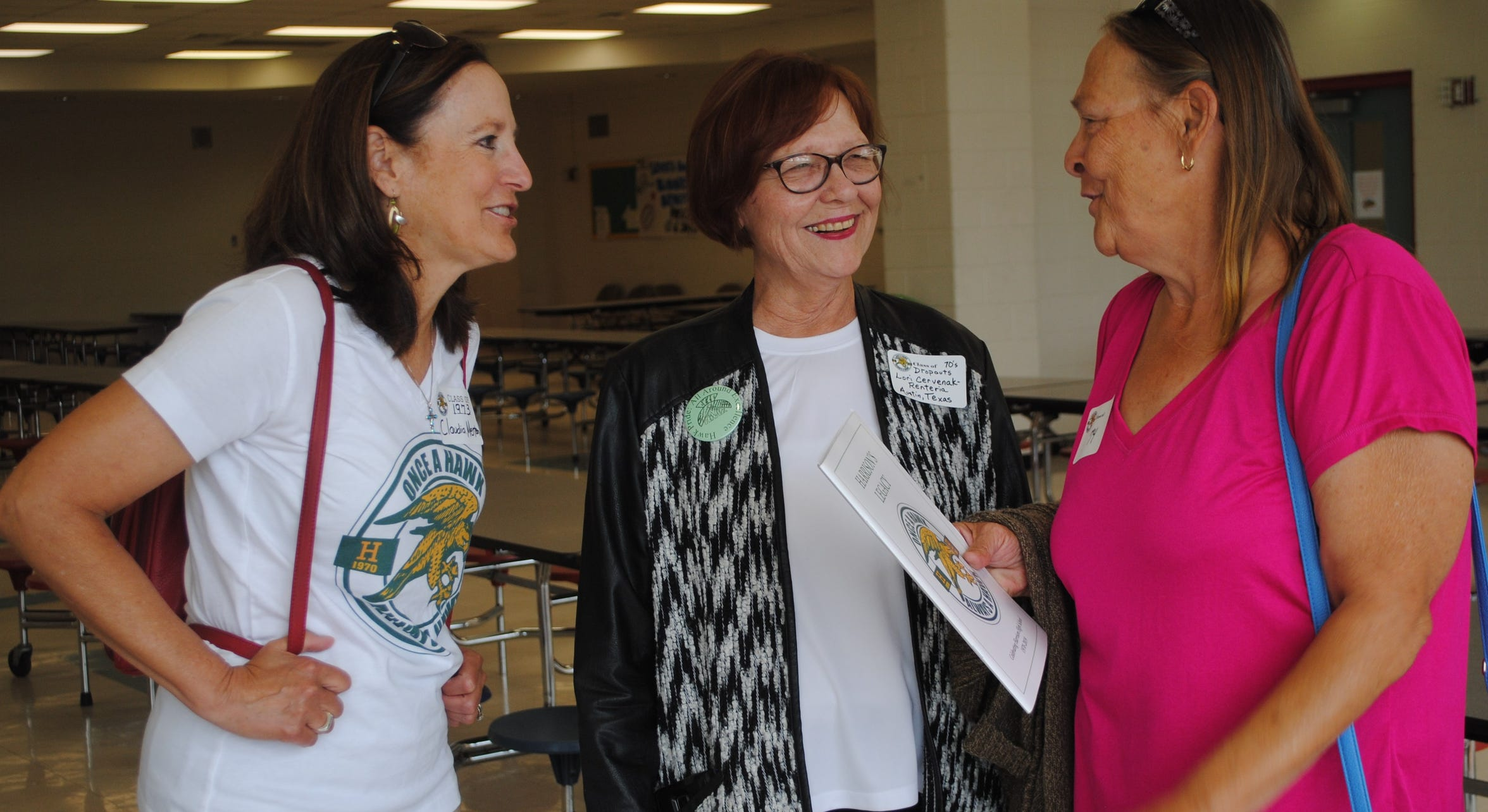 Claudia Menton, left, reliving high school with two of her former classmates during a final farewell event at Harrison on June 1.