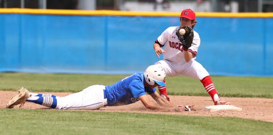 A Salem player hustles back to the base to beat a pickoff attempt.