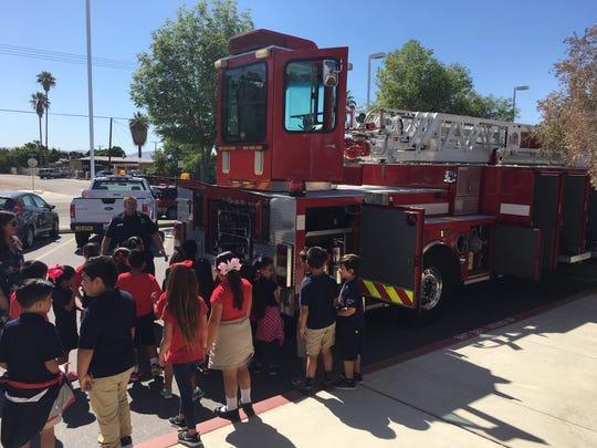 Students at Martin Van Buren Elementary tour a firetruck during career day.