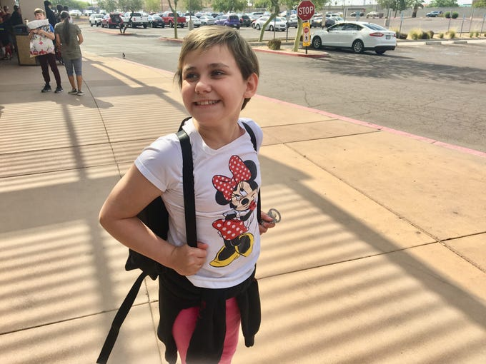 Isabella McCune was so excited about going to Camp Courage that she couldn't stop moving, dancing along the sidewalk and even turning a cartwheel.