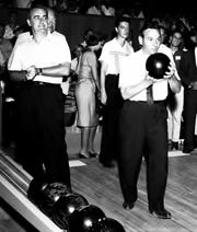 Jim Backus watches John F. Long bowl at Bowlero Bowling Lanes, 1959.