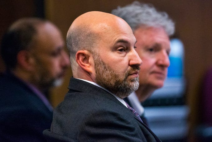 Avtar Grewal, left, and defense attornies  Jeffrey Kirchler and Richard Randall, right, listen to the opening argument by Maricopa County prosecutor Juan Martinez in Maricopa County Superior Court in Phoenix, Monday, June 3, 2019.  Grewal is accused of the first degree murder of his wife as well as burglary.