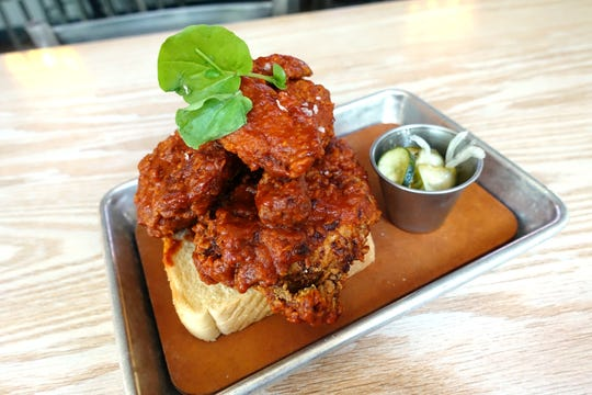 Nashville hot chicken with bread and pickles at High & Rye in Phoenix, AZ.