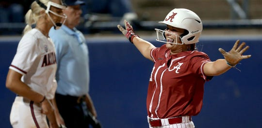 Alabama's KB Sides cruises home on a two-run double in the third inning for the only runs of the game in the Tide's 2-0 win over Arizona on Saturday night in Oklahoma City.