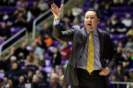 Northern Arizona coach Jack Murphy calls to his team during the first half of a game against Weber State, in Ogden, Utah, in 2018.