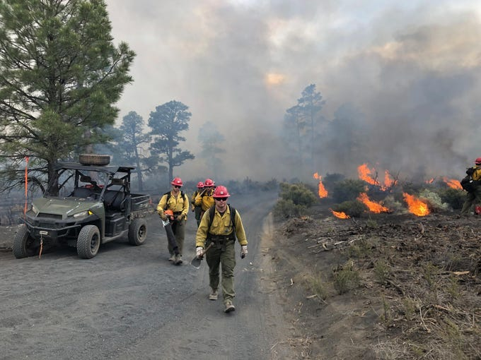 FIrefighters work on the Maroon Fire just north of Flagstaff. The fire has burned 7,000 acres.