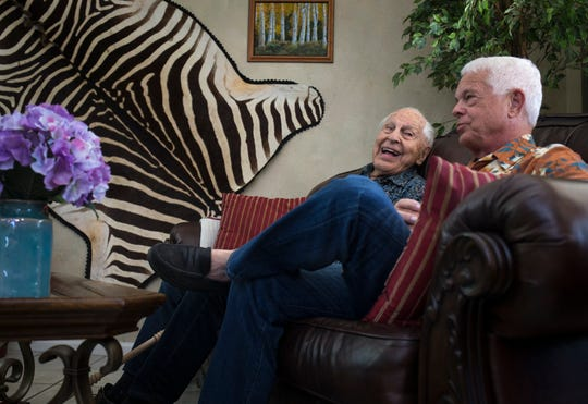 Fred Klein (left), a 103-year-old World War II veteran, and his son, Steve Klein, discuss how Fred initially agreed to pay $24K for the two high-end Trane air-conditioning units.