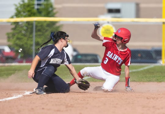 Marysville's Jolene Kruskie prepares to tag out St. Clair's Christina Bohm (3) as she slides into third base during softball district finals Monday, June 3, 2019 at Marysville High School.