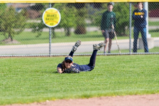 Marysville's Kaitlyn Cain dives for a catch during softball district finals against St. Clair High School Monday, June 3, 2019 at Marysville High School.