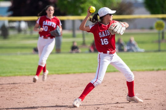 St. Clair's Aubrey Card throws the ball after making a catch during softball district finals against Marysville Monday, June 3, 2019 at Marysville High School.