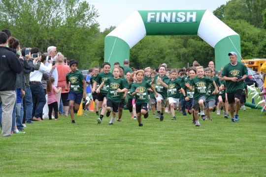 Members of the Junior Spartans Running Team ended the after-school running program with a celebratory 5-kilometer race at Vassar Farm and Ecological Preserve May 23.