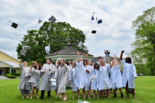 Maplebrook School graduates celebrate after commencement Sunday.