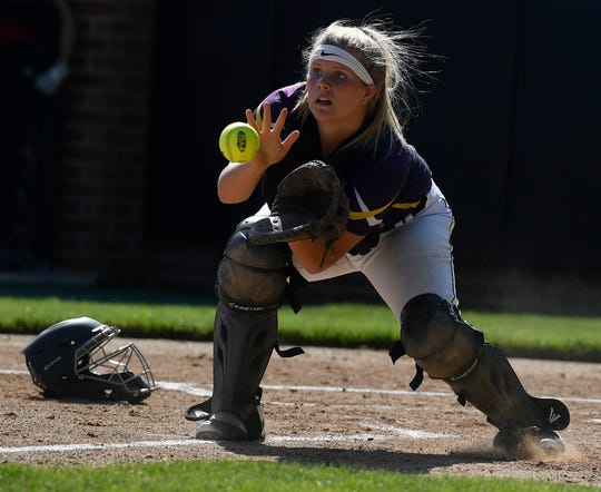 Eastern York catcher Morgan Winter fields a throw to out  Honesdale's Kaitlin Prince at the plate during the PIAA Class 4-A first-round state softball playoff game, Monday, June 3, 2019.