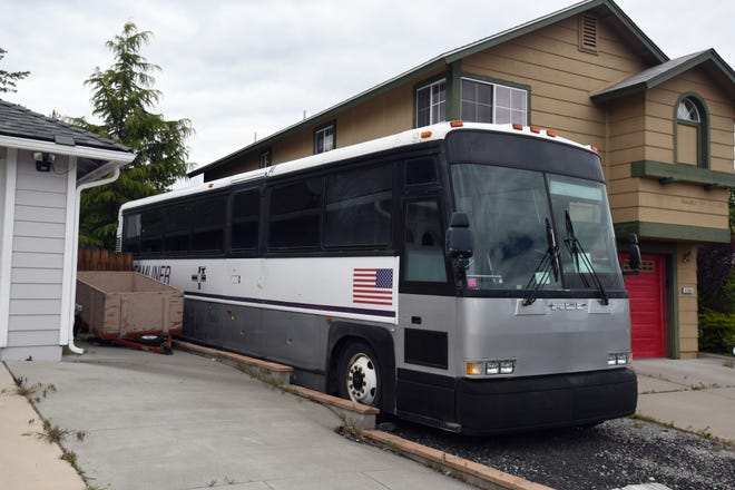 A bus bearing the logo of Inland Streamliner is parked at a residence in northwest Reno. The residence is the same address listed on Inland Streamliner's Nevada business license, according to the secretary of state's office.