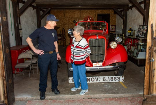 Rich Harvey, Fire Chief, Central Lyon County Fire Department, talks with Mabel Masterman, Dayton Valley Historical Society Secretary and Past President and Firehouse Jail Docent in front of the 1935 Ford American La France fire truck in Dayton's historical fire station.