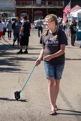 Leini Winward, 15, of Dayton, walks her dog Mochi, an 8-week old poodle.