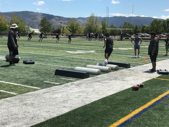 Football players displayed their skills and worked on several aspects of the game on Saturday at Manogue.