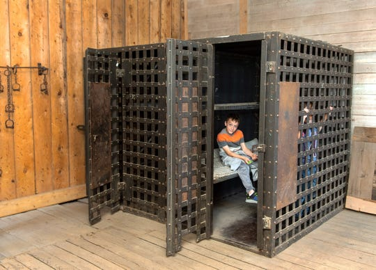 Jacob Powell, 8, checks out the jail cell inside DaytonÕs historic fire station.