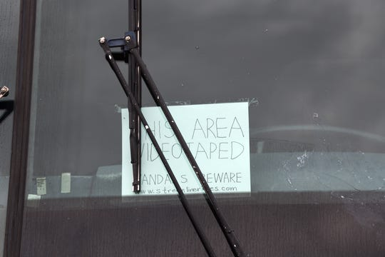 A sign taped inside the windshield of the Inland Streamliner bus warning would-be vandals that the area is videotaped.