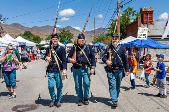 Sam Schornbus, Robert Burr and David Cooper, left to right, of the Nevada Civil War Volunteers walk along Pike Street.