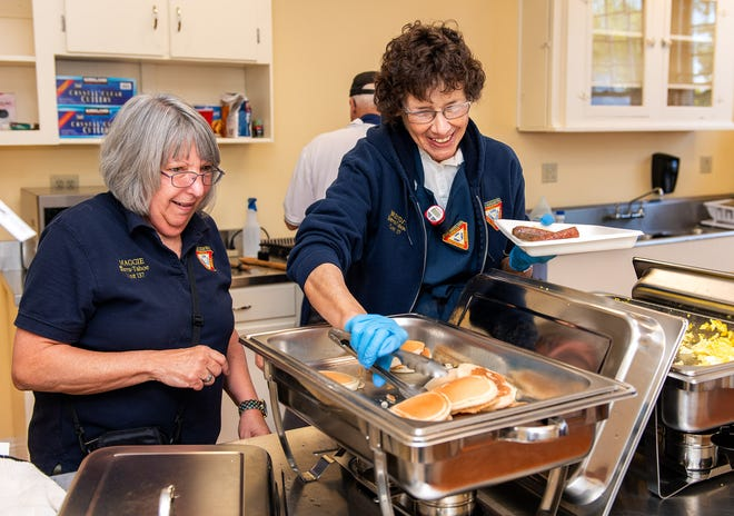 Maggie Smith, left, and Brenda Horton dish up plates for the pancake breakfast.