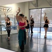 "Ananda Bena-Weber choreographing in the style of Argentine tango for SNB's ""Twelfth Night - A Ballet Noir."""