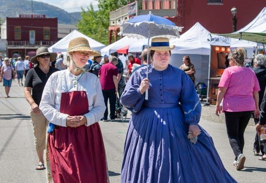 DebiLynn Smith, left, and Rebecca VanSickle, of the Nevada Civil War Volunteers, dress in period costumes.