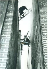 Richmond firefighters hazard climbing between buildings during a blaze at Richmond's General Telephone headquarters at 31 North Ninth on the frigid morning of Feb. 4, 1965. This fire created the worse communications blackout in Hoosier history. Today's story is about firefighters fighting torrential winds on June 10, 1963, two years prior, and the surprise they find.