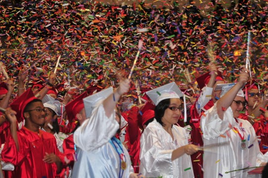 Graduates celebrate with confetti Sunday, June 2, 2019, in Tiernan Center.
