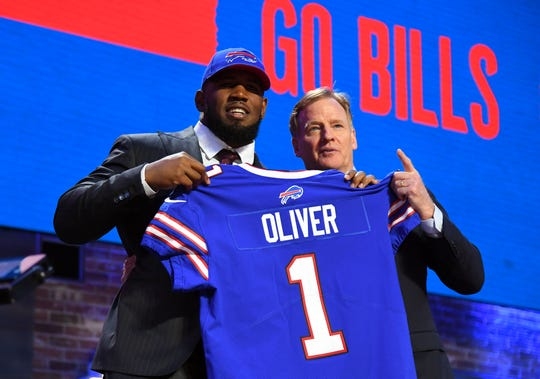 The Bills' first-round pick, Ed Oliver, poses with NFL commissioner Roger Goodell in Nashville.