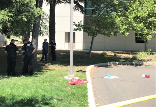 Redding police investigate a shooting outside the Redding Library on Monday afternoon.