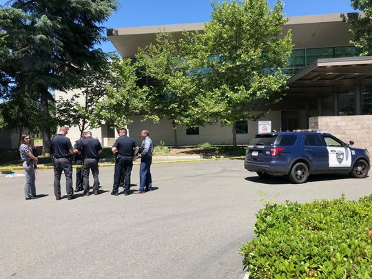 Police on Monday, June 3, 20196 investigate a shooting outside Redding Library.