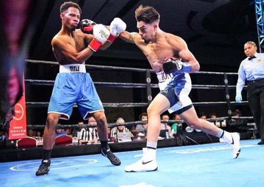 Everett Alvarez alum Justin Cardona (right) earned the second knockout of his boxing career Saturday in San Jacinto, Calif.