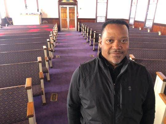 The Rev. Kelvin Jones inside First Baptist Church in Capeville, Virginia.