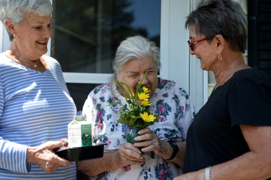 [From left] Barbra Hanson, Ruth Larmore and Darlene Cole-Cutter prepare to pose together in the sun outside Larmore's Salisbury home on Monday, June 3, 2019, for a photo as Larmore receives her latest meal from the MAC Senior Nutrition Program. The pair of volunteers have been delivering meals to seniors for the past 13 years.
