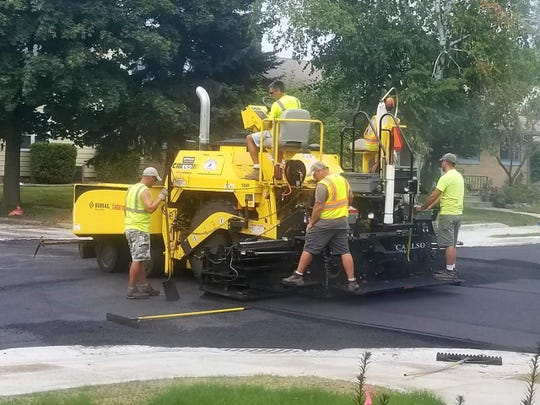 Workers tend to streets in Sheboygan.