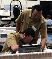 Silver medal winners Christopher Russell and James Gutierrez, Lakeshore Technical College students, competing in the Mechatronics category at SkillsUSA in Madison.