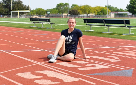 Jackie Turner, a cross country and track athlete at Augustana, sits on the O'Gorman High School track that the Vikings use for practice Friday, May 31, in Sioux Falls. Turner is going into her senior year and has overcome a series of challenges during her collegiate career, including brain surgery.
