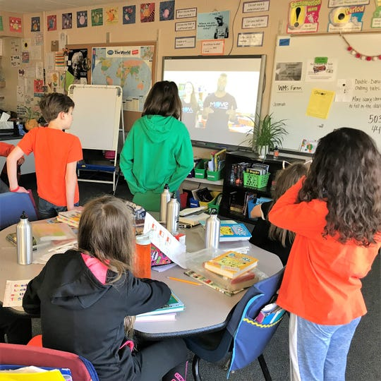 Children in Lindsey Olson's fifth grade class at Cleveland Elementary watch a Move This World video Friday, May 10, 2019. The video is a daily warm-up activity that's part of a new emotional well-being program meant to help children better understand the emotions they're feeling.