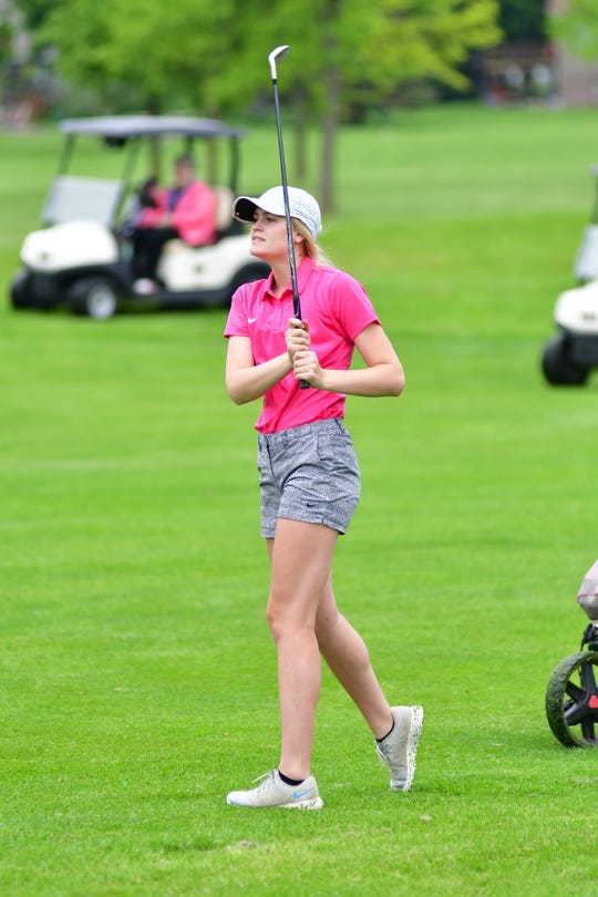Burke's Taylee Indahl tracks her shot at the 2019 Class B state golf tournament in Yankton.