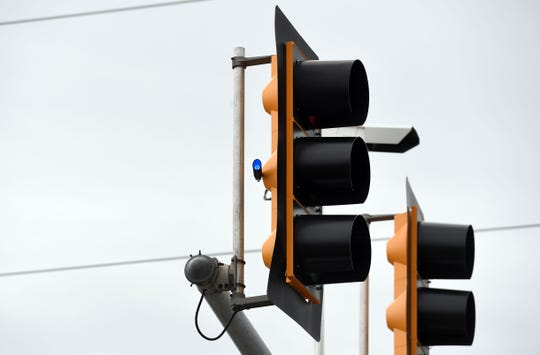 Red light reinforcement beacons are affixed to stoplights at various intersections Monday, June 3, in Sioux Falls.