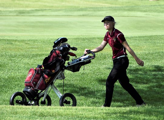 Roosevelt's Natalie Poppens walks between holes at the 2019 Class AA state golf tournament in Watertown.