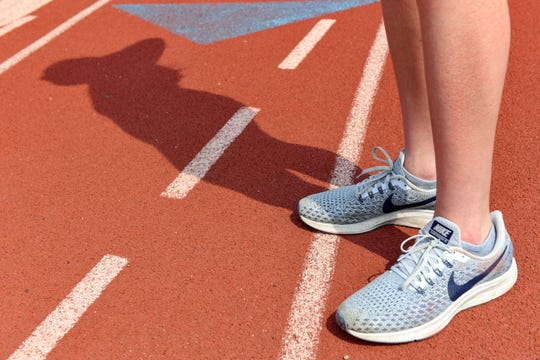 Jackie Turner stands on the O'Gorman High School track that the Augustana track team uses for practice Friday, May 31, in Sioux Falls. Turner has not been able to compete in three years due to a variety of complications.