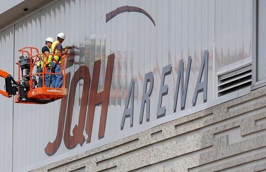 A crew removes the JQH Arena signage from the outside of JQH Arena on Monday, June 3, 2019. The arena will continue to be called JQH Arena until a new naming rights agreement is reached