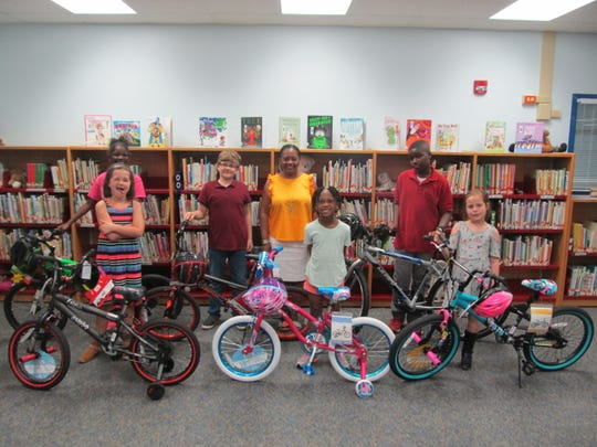 Sealey Elementary School Math & Science Magnet School had a free bike and helmet giveaway contest. The winners, pictured with Mrs. Demetria Clemons, principal, include Alivia Scott, Alyssa Jannett, Mohamad Alhalabi, Ashlynn McKee, Kaidence Kimbrough, and Metrius Hadley.